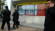 Asian markets meek after global turbulence